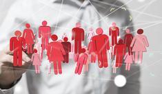 Dessin virtuel de plusieurs personnages de couleur rouge devant un homme